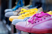 Colourful plimsolls in a row — Stock Photo