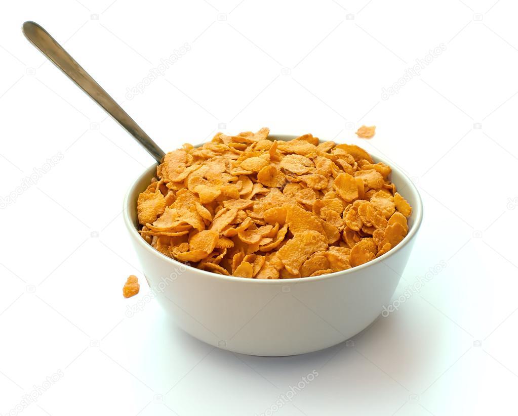 Taz n de cereal hojuela de ma z con una cuchara fotos de for Tazon cereales
