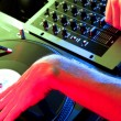 DJ scratching records in club environment — Stock Photo