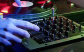 DJ using both hands on a mixer setup — Stock Photo