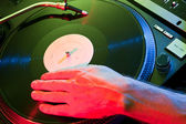 DJ hand scratches vinyl — Stock Photo