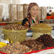 Woman trading on a market, Samarkand, Uzbekistan - Stock Photo