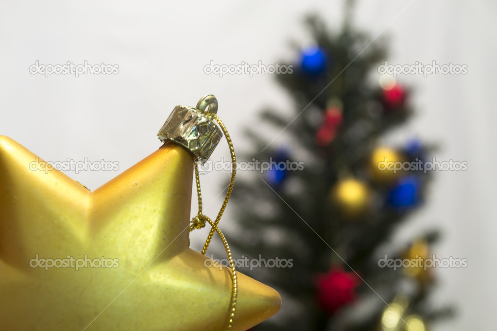 Christmas toy on a background of trees  Stock Photo #16258047