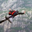 Parachute jump over the wall. - Stockfoto