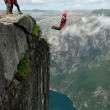 Foto Stock: BASE jump off cliff.