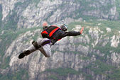 Parachute jump over the wall. — 图库照片