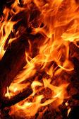 Illustration of burning fire flame on black background — Stock Photo