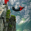 BASE jump off a cliff. — Stock Photo #14825125