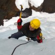 Man climbing frozen waterfall — Stock Photo #14825957