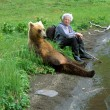 Walk with a bear - Stock Photo