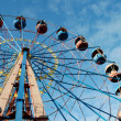 Observation wheel in amusement park - Stock Photo