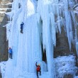 Man climbing frozen waterfall — Stock Photo #16322837