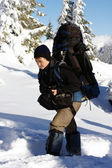 Hiker in winter mountains snowshoeing — Stock Photo
