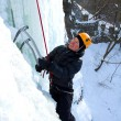 Man climbing frozen waterfall — Stock Photo #16871773