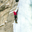 Stock Photo: Ice climbing the waterfall.