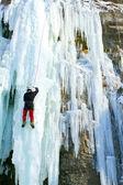 Ice climbing the waterfall. — Stock Photo