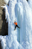 Ice climbing the waterfall. — Stok fotoğraf