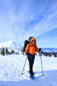 Winter hiking in the mountains on snowshoes. — Stock Photo