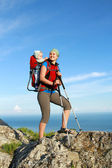 Mum walks with the child in the child carrying it. — Stock Photo