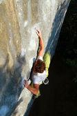 A man climbs a wall. — Stock Photo