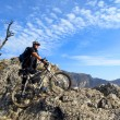 Cyclist on the top of a hill — Stock Photo