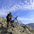 Stock Photo: Cyclist on the top of a hill