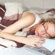 Bored woman sick in bed — Stock Photo #14233679