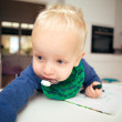 Blonde infant in home setting - Foto Stock