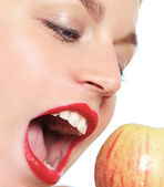 Beautiful woman biting apple — Stock Photo