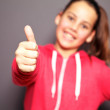 Happy girl gives the thumbs up — Stock Photo