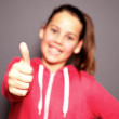 Happy smiling child giving a thumbs up — Stock Photo