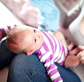 Beautiful small baby on its mothers lap — Stock Photo