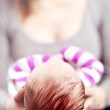 Mother cradling her newborn baby — Stock Photo