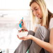 Woman smiling as she tucks into breakfast — Stock Photo #20390259