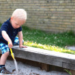 Little boy playing in sand pit — Stock Photo #28004351