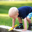 Cute little boy climbing a wall — Stock Photo