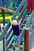 Little boy climbing steps at the playground — Stock Photo