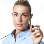 Businesswoman drawing an arrow graph — Stock Photo