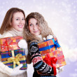 Happy girlfriends with christmas presents — Stock Photo