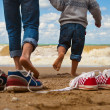 Stock Photo: Father and son walk at seaside