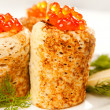 Stock Photo: Roll from russipancake with salmon caviar