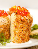 Roll from russian pancake with salmon caviar — Stock Photo
