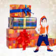 Little christmas elf with gift boxes — Stock Photo #14545379