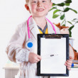 Little doctor with clip board — Stock Photo