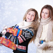 Two girlfriends with christmas presents — Stock Photo #14545449