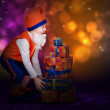 Stock Photo: Surprised little gnome with gift boxes
