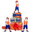 Stock Photo: Three posing gnomes with gift boxes 1