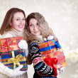 Happy girlfriends with christmas presents - Photo