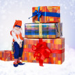 Little gnome with christmas gift boxes - Stock Photo