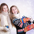 Two girlfriends with christmas presents - Photo
